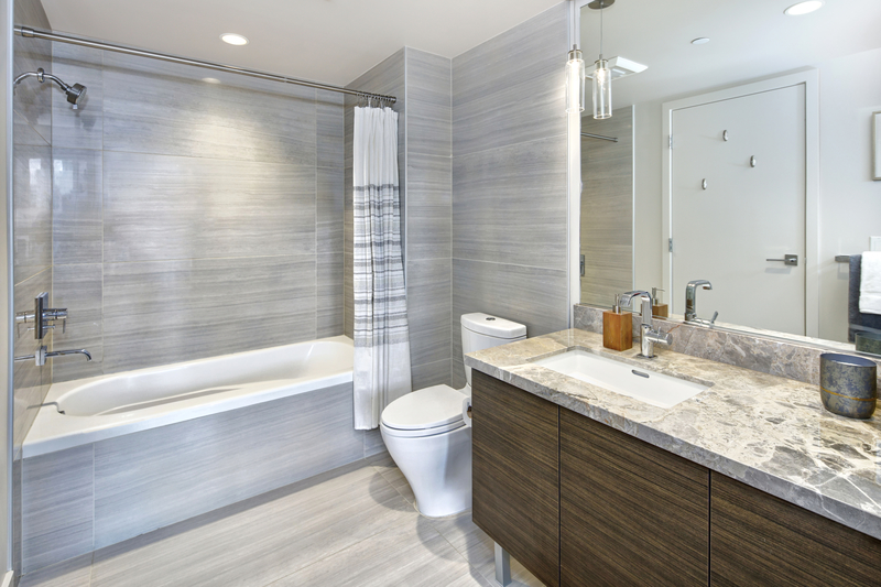 Basement Bathroom Design - Econo Basement - Basement and Garage Services Calgary - Featured Image